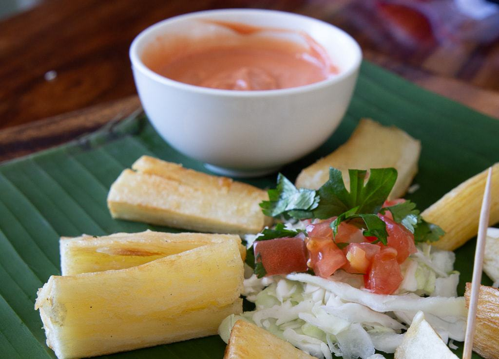 plate of yuca fries with salad and dipping sauce costa rica