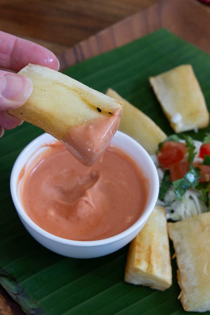 yuca fry dipped in pink sauce