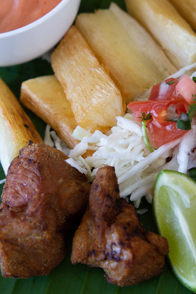 chicharron de cerdo costa rica with yuca fries and lime