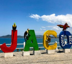 Colorful sign in front of Costa Rica's Jaco beach.
