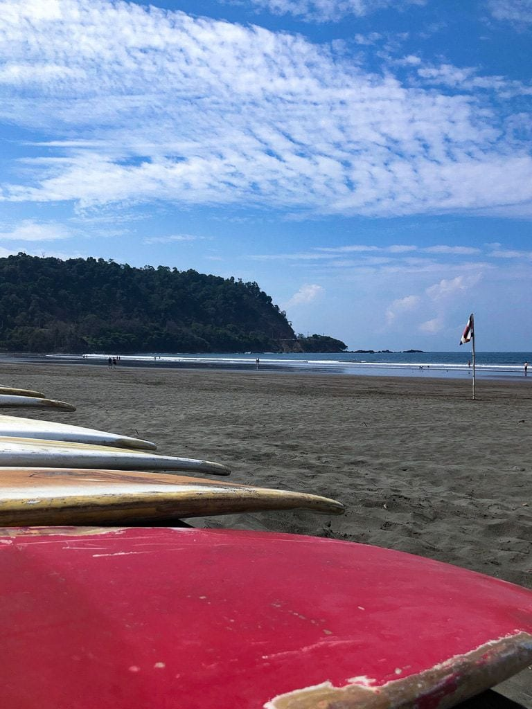 Surf boards on the beach at low tide, Jaco Costa Rica.