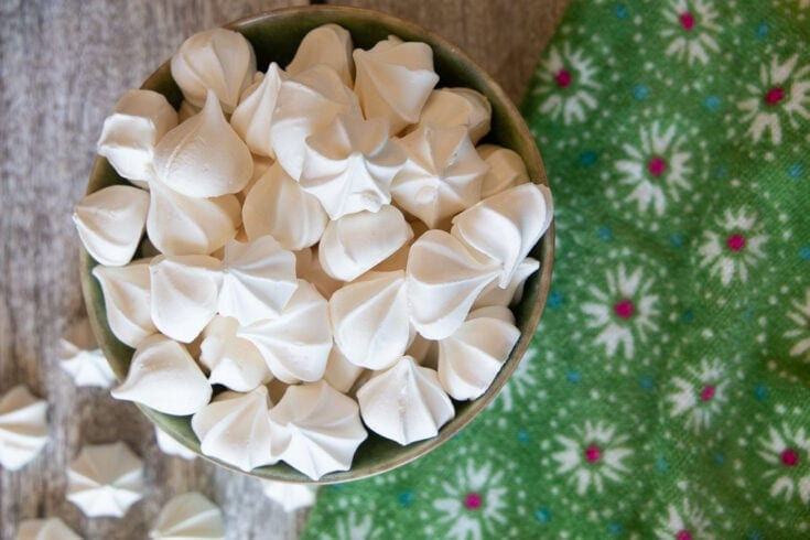 Bowl of small white meringue cookies.