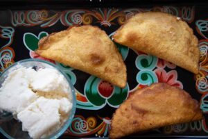 Fully fried cheese empanadas with queso fresco.