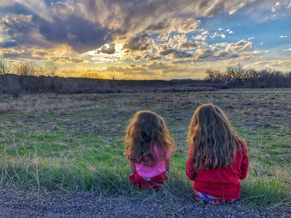 Two girls admiring a sunset.