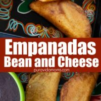 A couple of Bean and Cheese Empanadas on a place mat.
