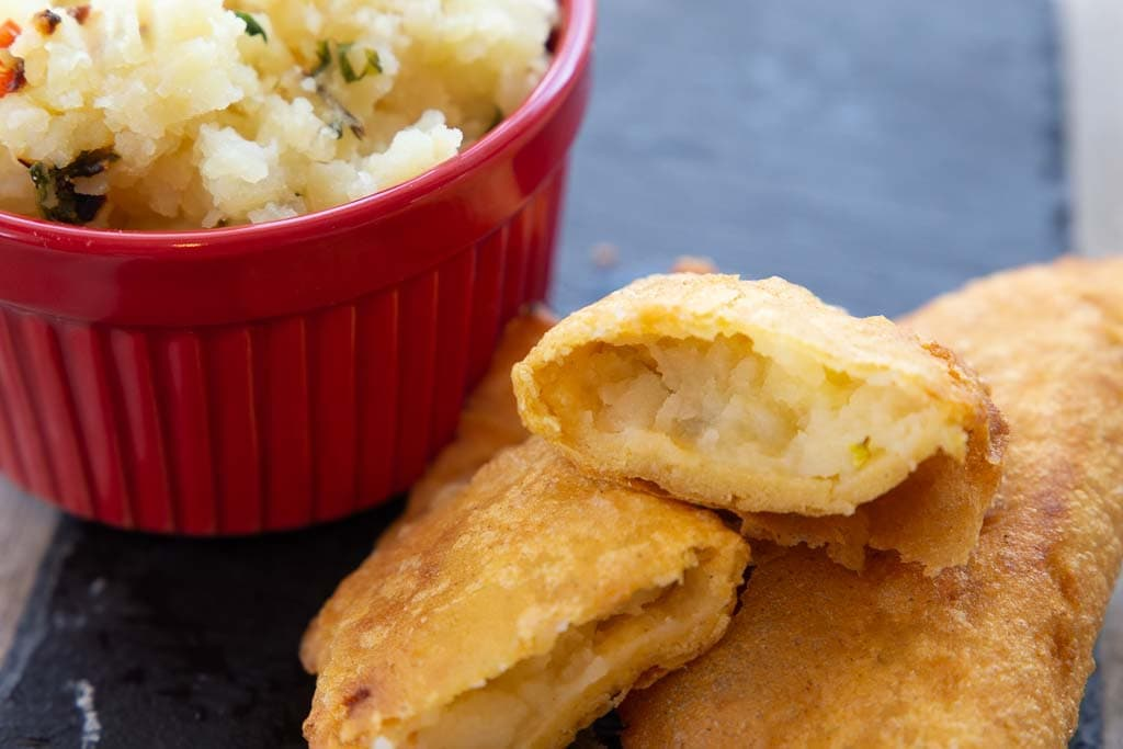 Close-up of halved potato empanada.