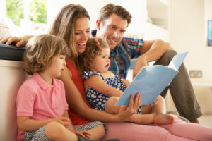 Four-person family enjoying a story.
