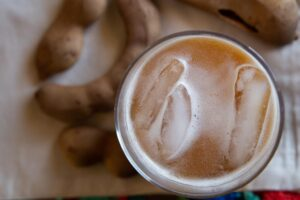 Close-up of tamarindo juice with ice floating on top.