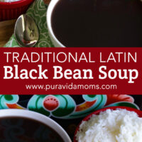 Black bean soup in a white bowl with a side of rice.