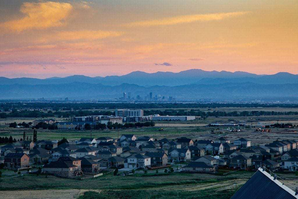 Sunset over the city and distant mountains at Gaylord Rockies.