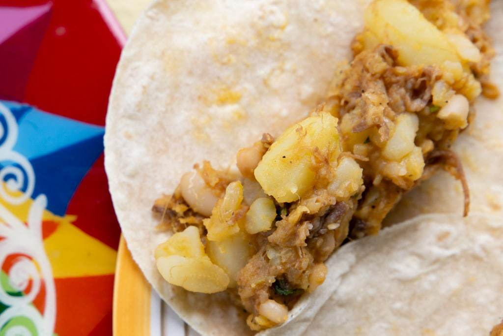 Tortilla with a serving of potato hash in its center.