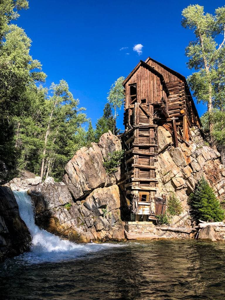vertical shot of crystal mill colorado in summer