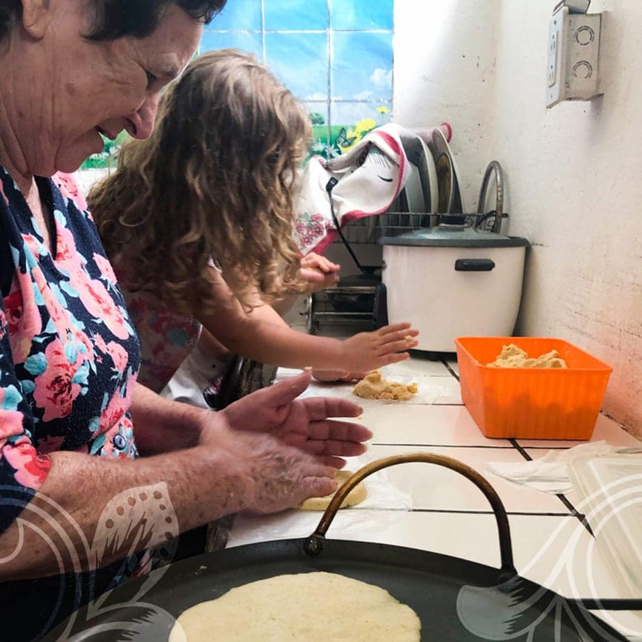 A older women and young child making food together.