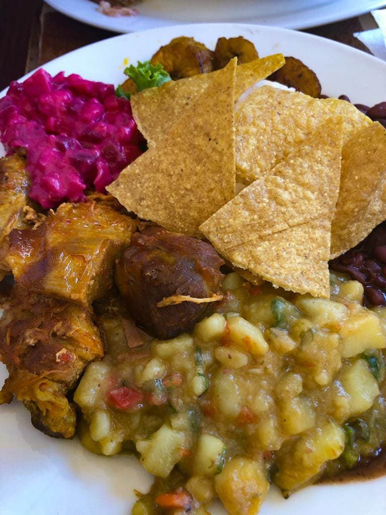 Casado platter topped with tortilla chips.