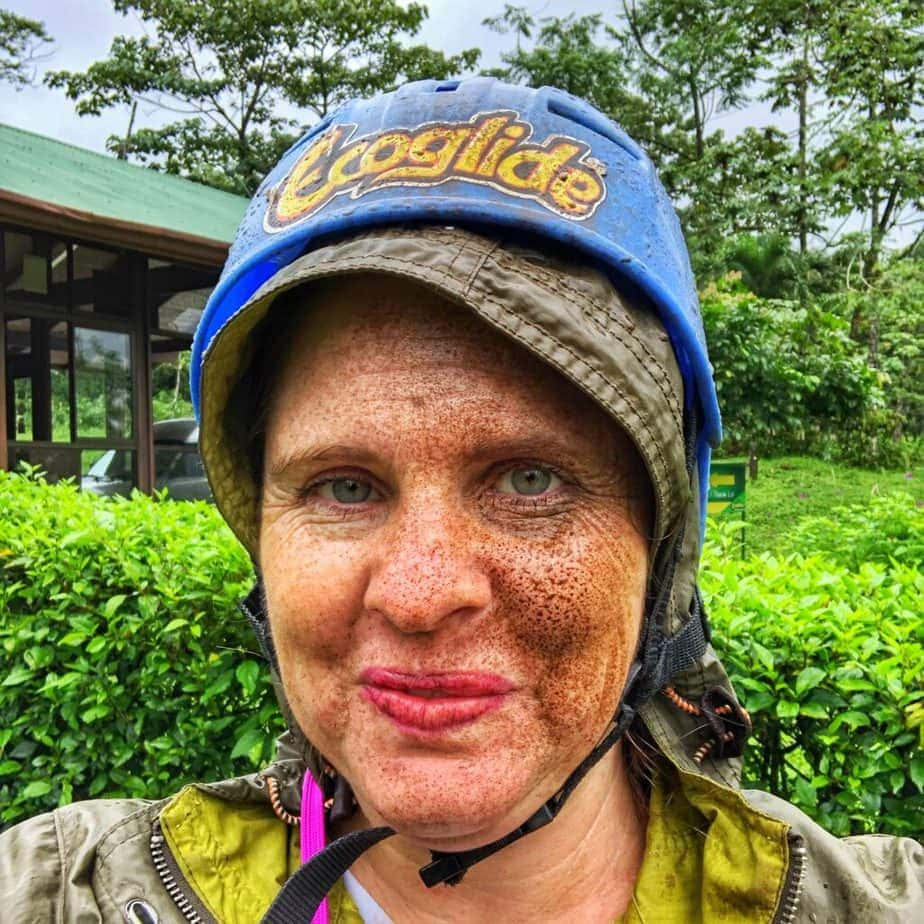 woman's face covered in mud after ziplining in la fortuna costa rica