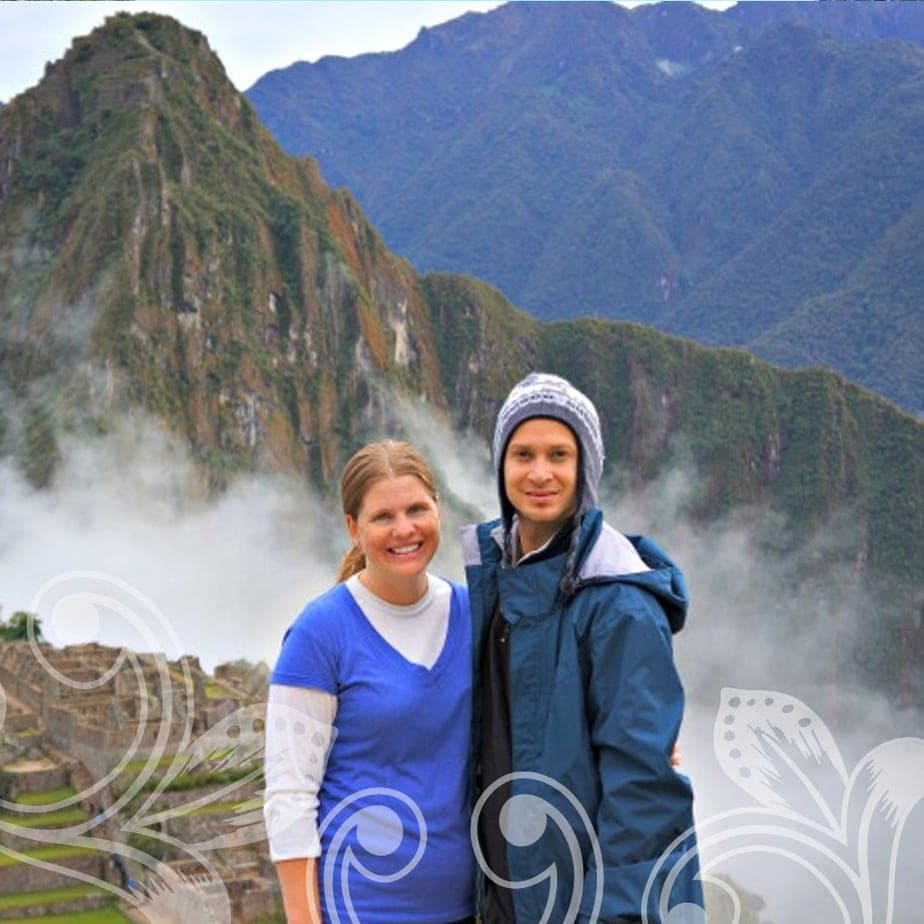 Two women standing on misty mountains.