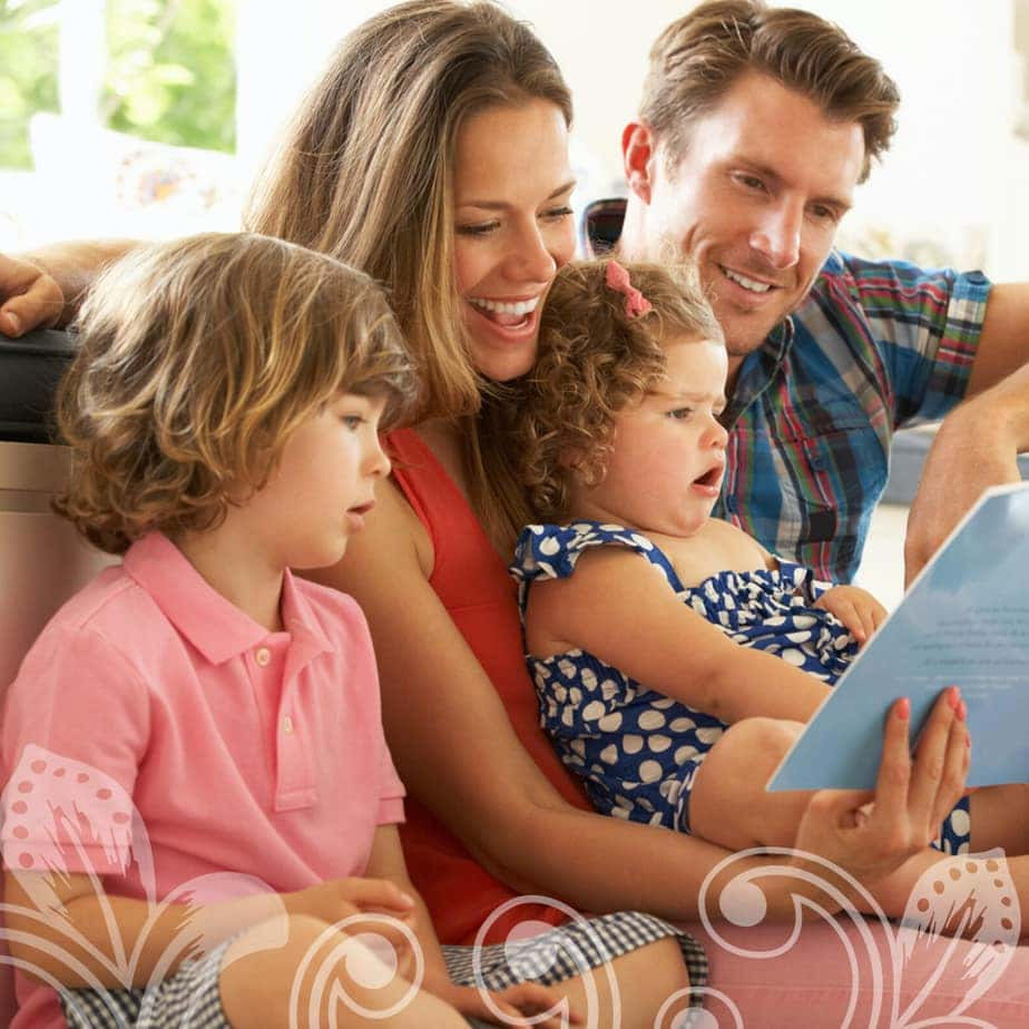 A family reading a book together.