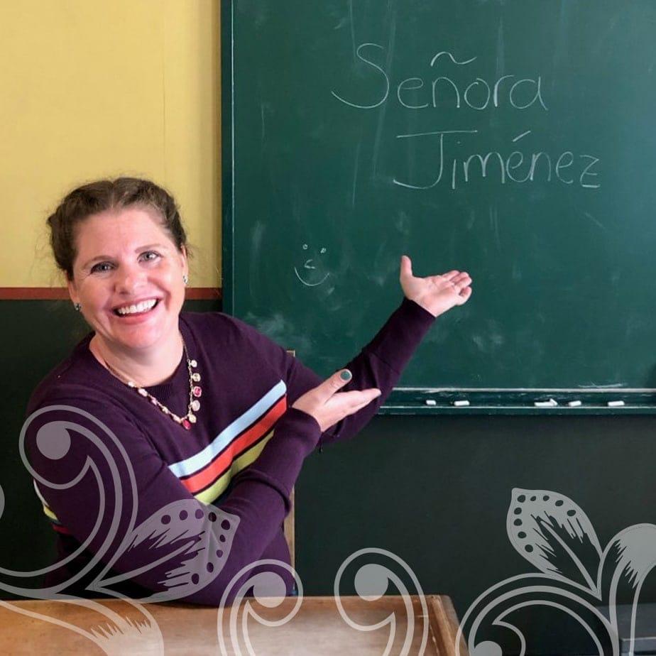 A women in front of a chalk board.