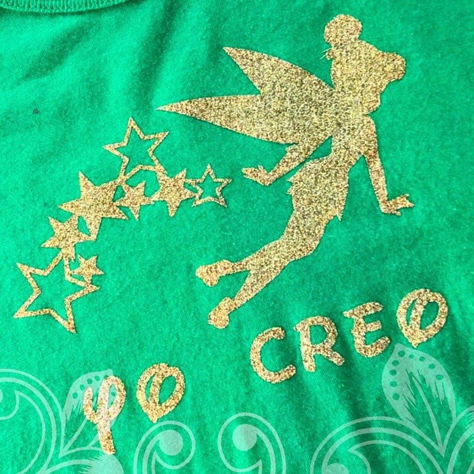 A green shirt with a golden Tinkerbelle on it.