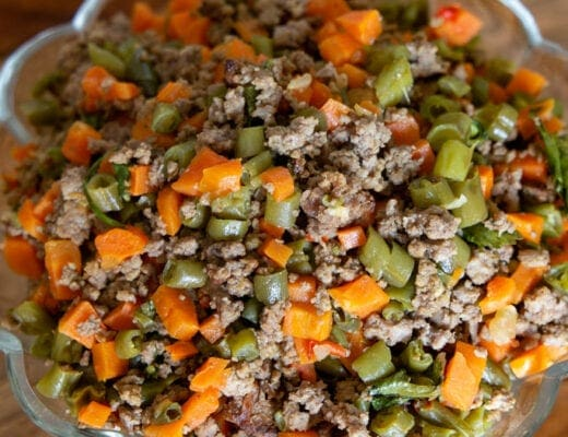 cropped image of costa rican picadillo in scalloped edged bowl.