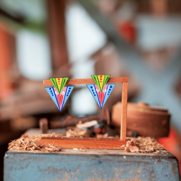blue double triangle earrings handmade in costa rica displayed on wooden stand.