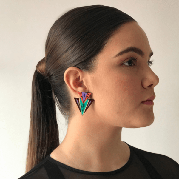 double triangle teal earring handmade in costa rica side view on woman.