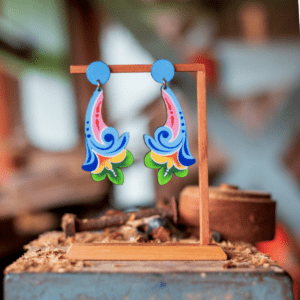 blue long costa rican flower earrings on wooden display.