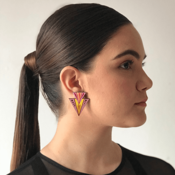 side view of handmade costa rican double triangle terracotta earring on woman.