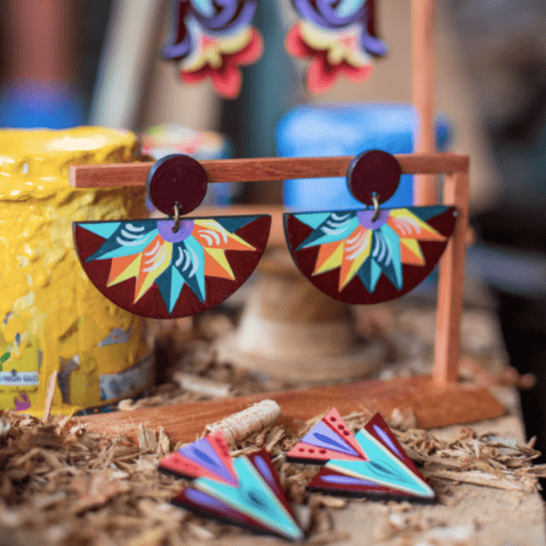 costa rican handmade earrings both half moon and downward pointing triangles.
