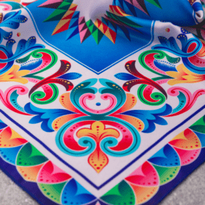 corner photo image of bright rainbow colored and patterned El Canto kerchief .
