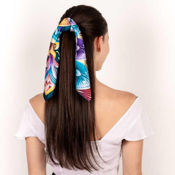 pastel blue purple and gold colored El Canto kerchief worn in hair as half ponytail accessory scarf.