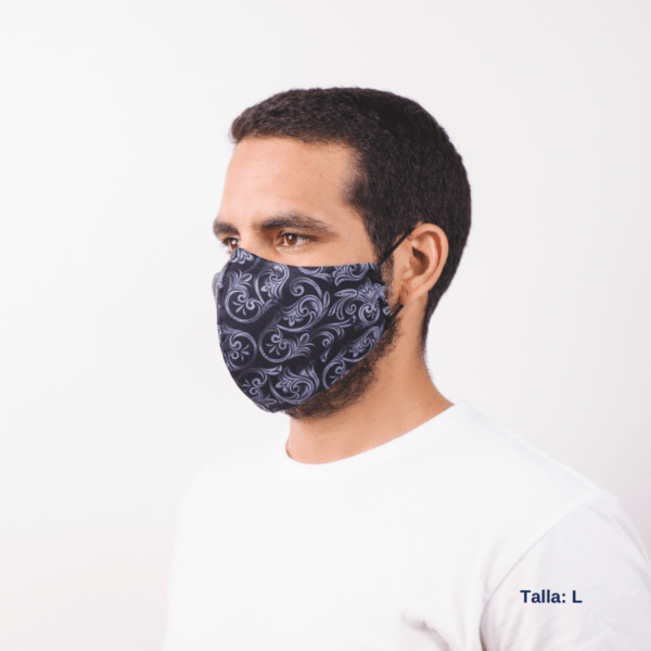 side view of man wearing large grey facemask with white costa rican designs.