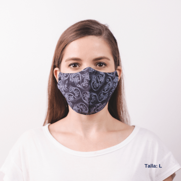 front view of woman wearing large grey facemask with white costa rican design.