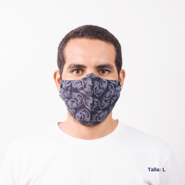 front view of man wearing large grey facemask with white costa rican pattern.