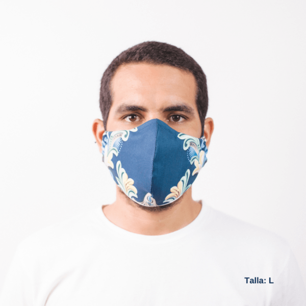 front view of man wearing large dark blue facemask with costa rican designs on side of mask.