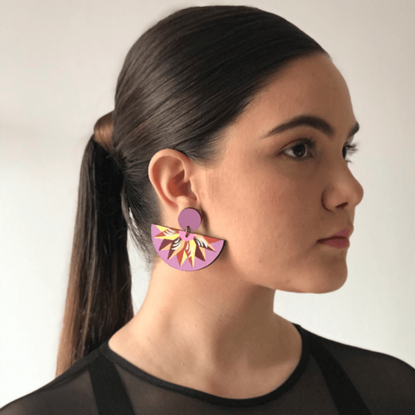 costa rican handmade lavender purple half circle dangling half moon earrings on woman with ponytail.