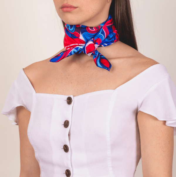 red, blue and white large sized El Cando kerchief worn as wrapped and knotted neck accessory scarf.