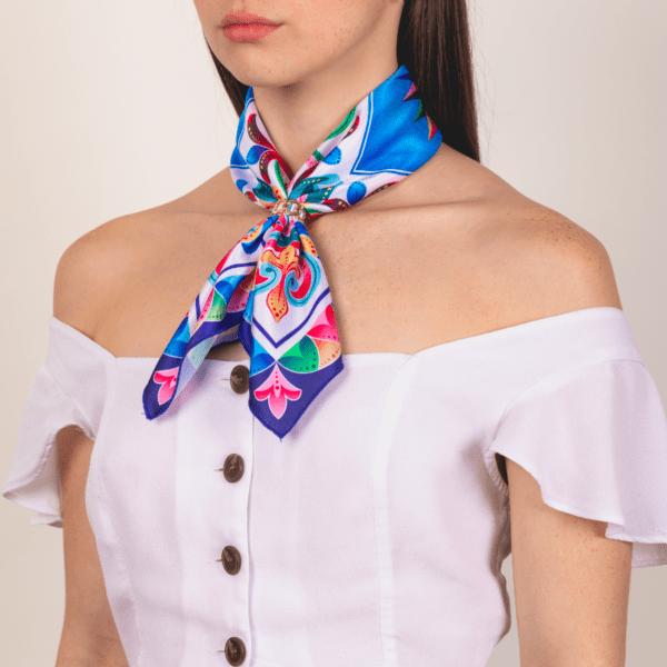 medium sized bright colored El Canto kerchief worn as long neck accessory scarf.
