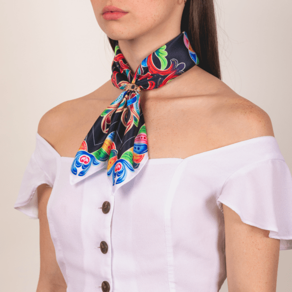 bold colored medium El Cando kerchief worn on woman as long neck accessory.
