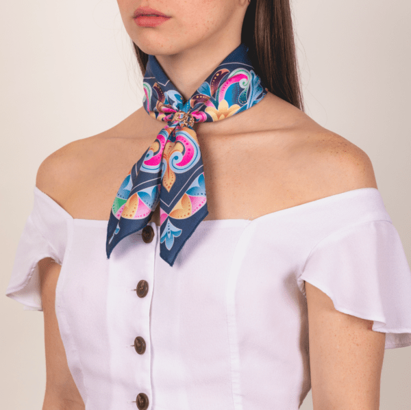 medium sized El Canto pastel colored kerchief worn on woman as long neck accessory piece.