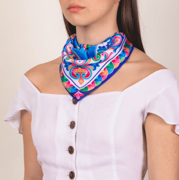bright colored costa rican kerchief by El Canto worn as décolletage piece.