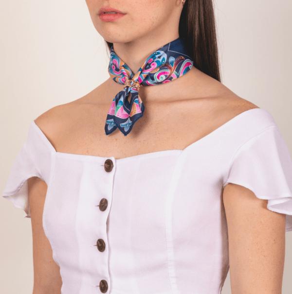 woman wearing pastel El Canto kerchief around neck .