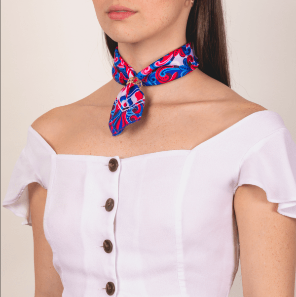 woman wearing blue, red and white scarf as short neckerchief.