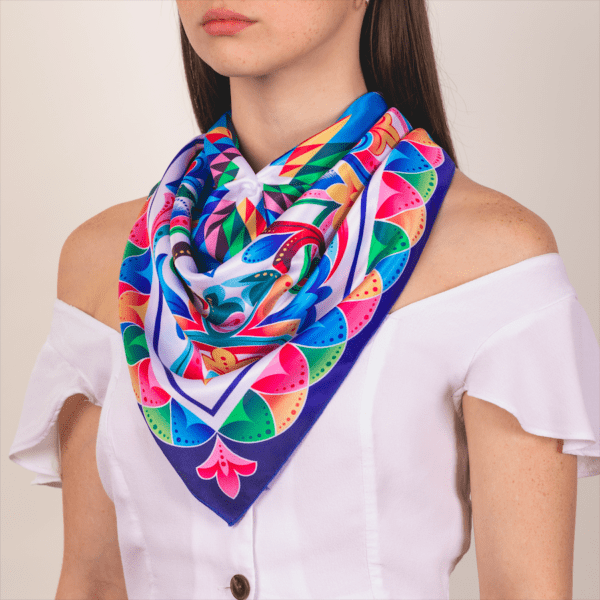 bright rainbow colored large sized El Cando kerchief worn as décolletage accessory scarf.
