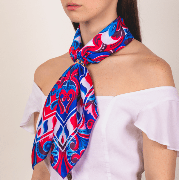 blue, red and white colored large El Canto kerchief worn as long neck accessory scarf.