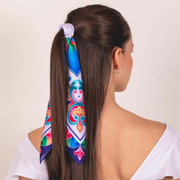 bright blue colored El Canto kerchief worn as half-ponytail hair accessory.