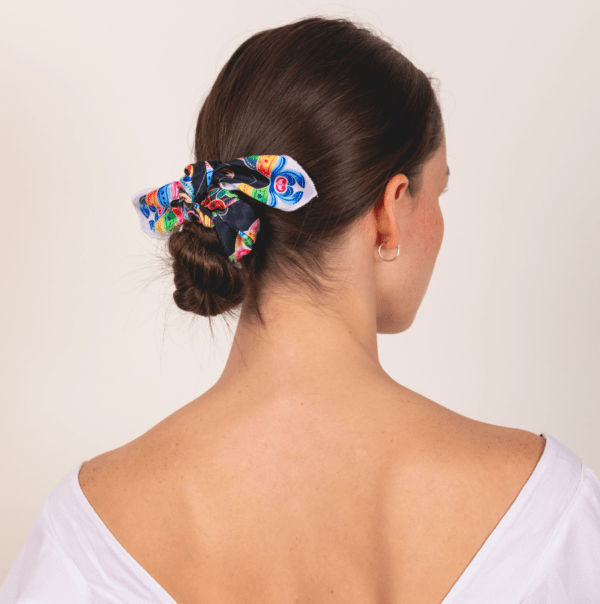 bold and black colored kerchief worn as hair updo accessory.