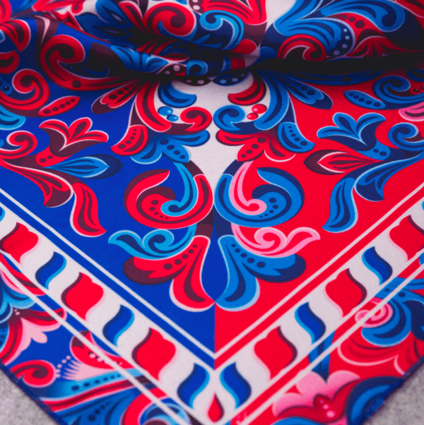 close up of corner of red, blue and white colored costa rican handkerchief.