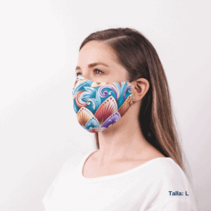 sideview of costa rican facemask featuring blues, purples and gold colors worn by woman.