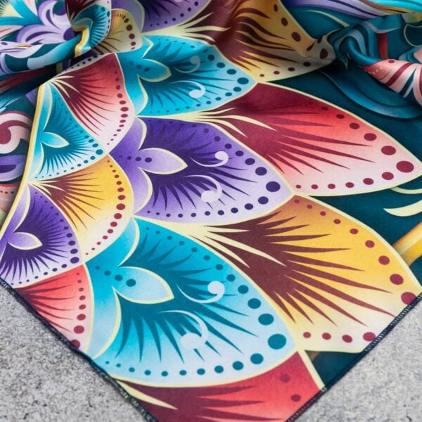 close up of costa rican patterned bright color scarf.